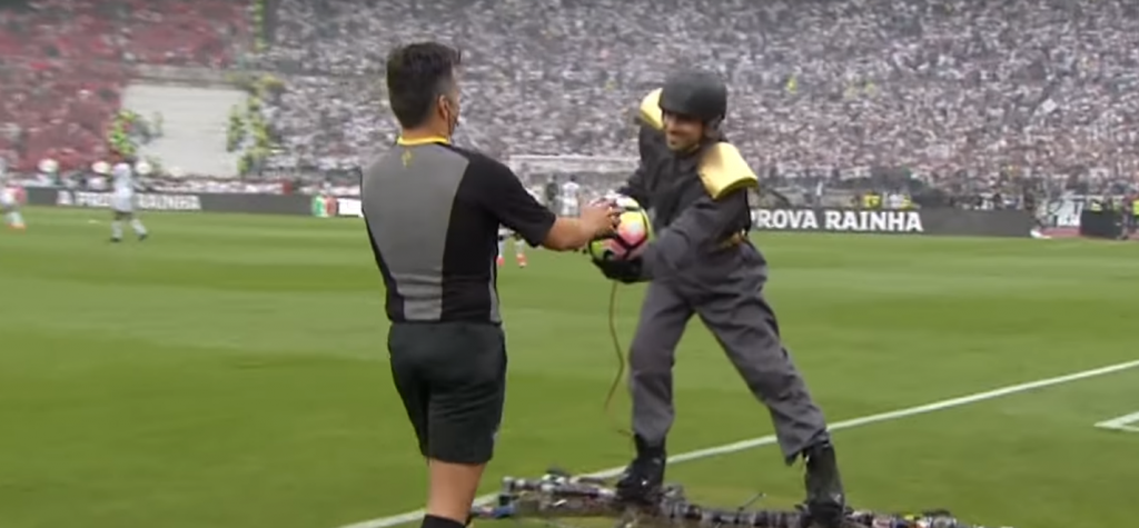 man flying drone delivery in portugal cup final football