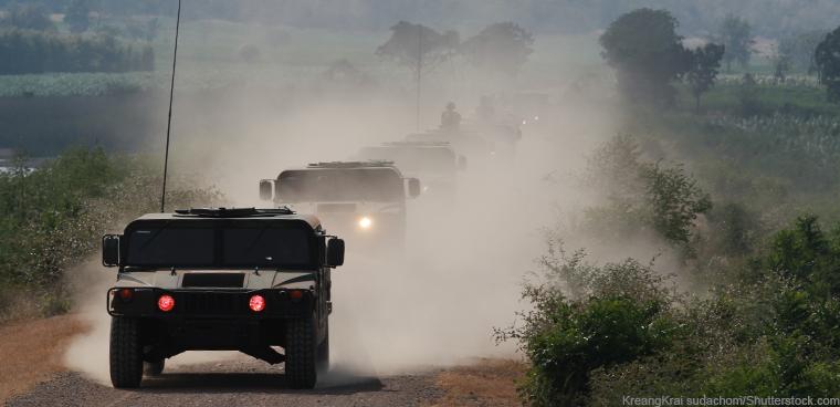 military convoy (KreangKrai sudachom/Shutterstock.com)