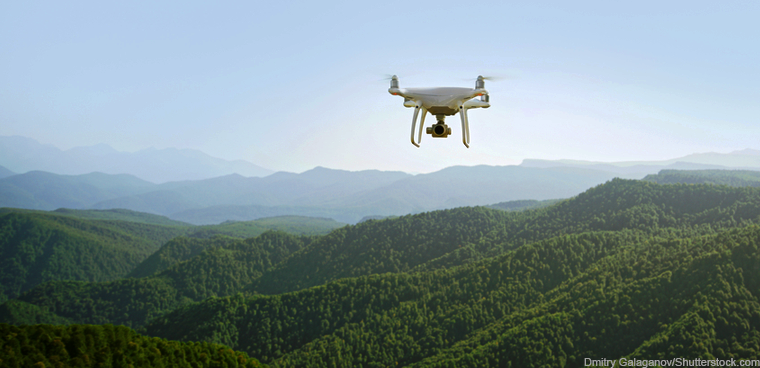 drone over wooded mountains (Dmitry Galaganov/Shutterstock.com)