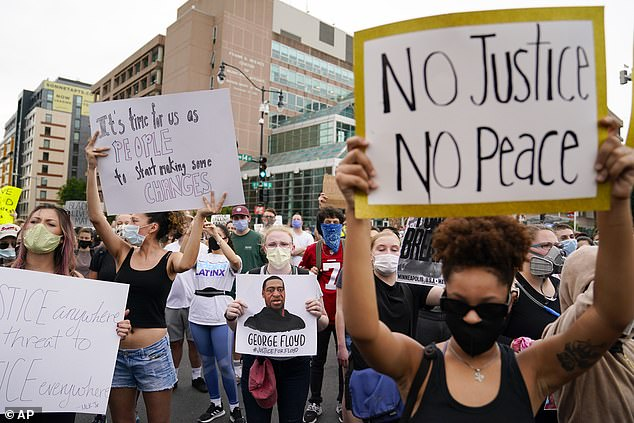 The drone flew over Minneapolis as the ity entered its fourth day of intense protests over the killing of George Floyd. Pictured, demonstrators gathered on Friday