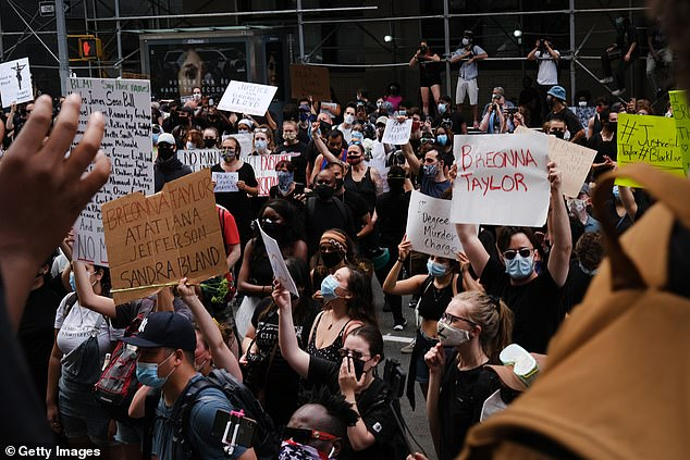 Protests also continued in New York, pictured, and the White House went into lockdown as protesters tried to scale the walls. Violence has erupted across the US for a fourth night, with protesters gathering at  Minneapolis, his hometown of Houston and  Washington DC