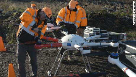The eight-foot drones are capable of carrying up to 57 pounds worth of seeds.